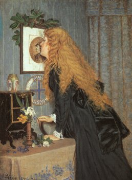 Young woman kissing herself in the mirror